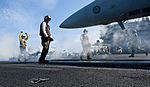 Defense.gov News Photo 120124-N-OY799-472 - U.S. Navy Airman Michael Linscott directs an F A-18E Super Hornet aircraft assigned to Strike Fighter Squadron 14 during flight operations on the.jpg