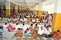 Devotees having Prasad in Anandabazar.jpg