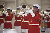 The U.S. Marine Drum and Bugle Corps performing shown performing a stationary concert feature.