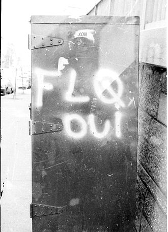October Crisis - A postal box in Montreal bearing the graffiti FLQ oui (FLQ yes) in July 1971. The FLQ conducted several bombings of post boxes which typically bore a decal of the Royal Coat of Arms of Canada.