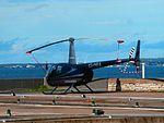ES-HRA Robinson R44 Raven I No 2024 City Hall Tallinn 6 September 2016.jpg