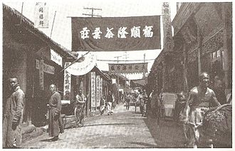 Kaifeng Jews - Earth Market Street, Kaifeng, 1910. The synagogue lay beyond the row of stores on the right