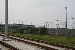 Edinburgh Park - Tram on Gogar viaduct (geograph 4167961).JPG