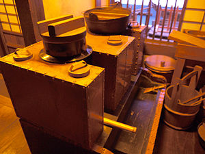 Kamado - The 18th century Merchant's kitchen, Stove boiler or kamado made of copper (Fukagawa Edo Museum)