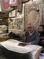 An old master of hand-printed carpets in Isfahan bazaar.