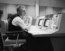 Eugene F. Kranz at his console at the NASA Mission Control Center.jpg