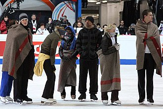 2011 European Figure Skating Championships - Skaters react to the rink's cold temperatures during the practice for the exhibition gala.