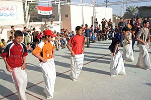 Sack race - A group of children in Fallujah, Iraq participating in a sack race