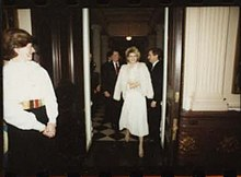 Fawn Hall entering room at White House Christmas Party for NSC staff, 1984.jpg