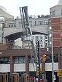 Firefighters service a ladder truck outside fire hall 333, Toronto, 2014 05 20 (1) (14258217934).jpg