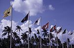 Flags outside Singapore International Airport, photographed February 1969 × July 1971.jpg