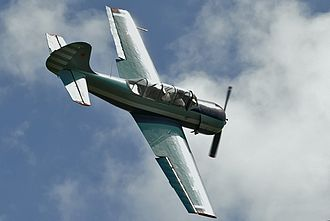 Aileron - A Yak-52 using ailerons to roll counter-clockwise during an aerobatic maneuver