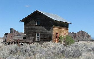 Fort Rock Valley Historical Homestead Museum - Belletable House in front of Fort Rock