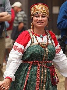 ade5d9c9e532 Sarafan worn with a Kokoshnik on a Russian folk festival