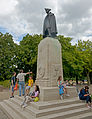 General Wolfe statue, pedestal, and tourists, Greenwich Park, London.jpg