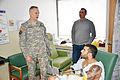 General visits wounded Soldier-Cop 140111-A-BD830-002.jpg