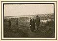 German officers walking with women (8805043638).jpg