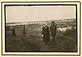 German officers walking with women (8805043638).jpg