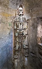 Gibbet with skeleton in Ypres Tower cell, Rye Castle.jpg