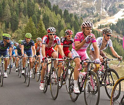 Starting in 1909, the Giro d'Italia is the Grands Tours' second oldest. Giro d'Italia 2012, 072 pampeago rodriguez met puffertje (17786750665).jpg