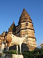 Goat with old temple in Orchha, MP, India.jpg