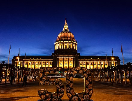 San Francisco City Hall lit in orange, three days before the Super Bowl 50 Gold for Super Bowl 50 (24826175235).jpg