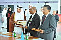 H.E. Dr. Hamad bin Abdulaziz Al-Kawari, Ambassador M. Anthony Maruping and Mr. Kobsak Chutikul at the exchange of presents (6941360660).jpg