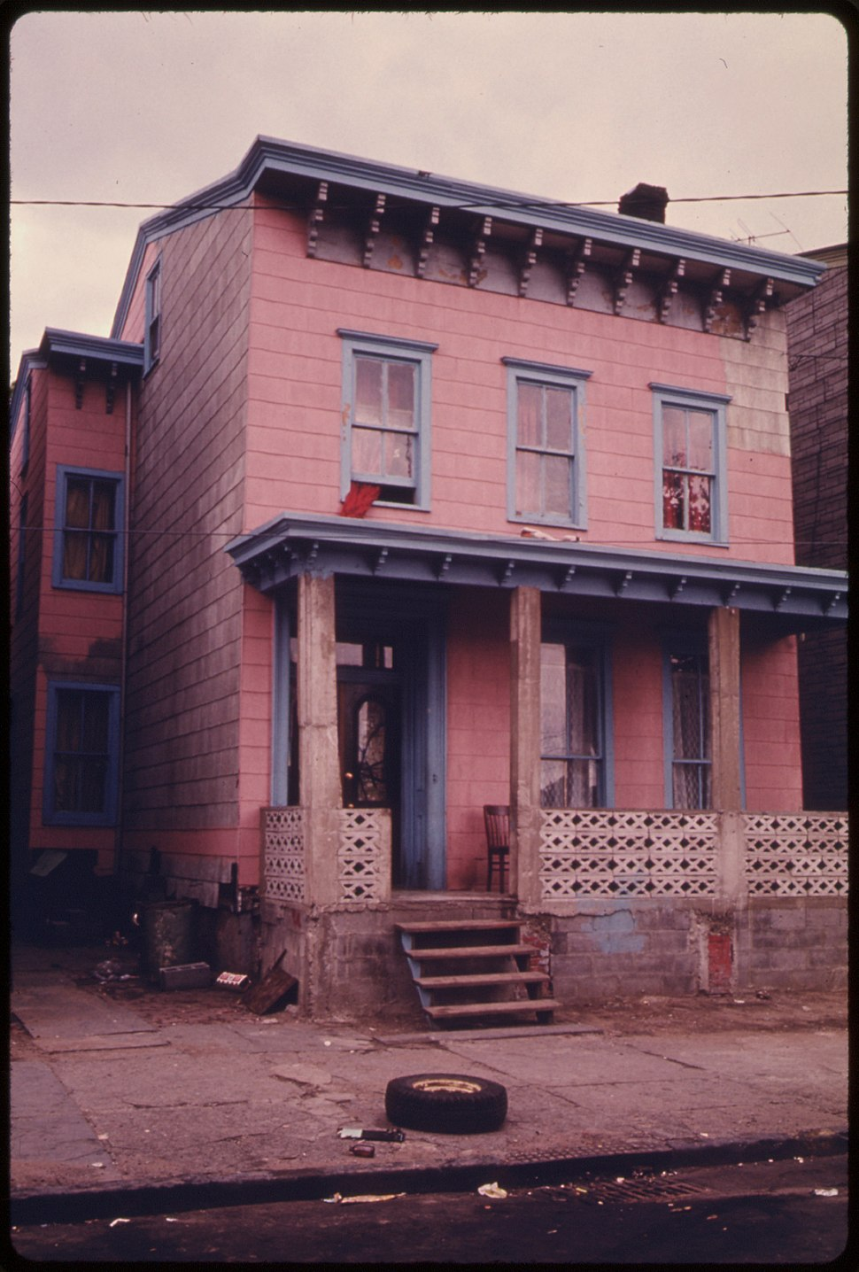 HOUSE IN THE INNER CITY OF PATERSON, NEW JERSEY. THE INNER CITY TODAY IS AN ABSOLUTE CONTRADICTION TO THE MAIN STREAM... - NARA - 555903