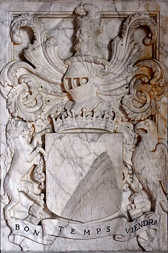 """Henry Bourchier, 5th Earl of Bath - Marble panel with  relief sculpture of heraldic achievement of Henry Bourchier, 5th Earl of Bath, detail from his monument in Tawstock Church, Devon. The escutcheon shows 53 quarterings (as on the monument to William Bourchier, 3rd Earl of Bath in the same church), with supporters, dexter: an heraldic tiger argent; sinister: a falcon argent beaked and membered or the wings elevated vulned gules. Above is the crest of Bourchier: A man's head in profile proper ducally crowned or with a pointed cap gules; below the motto of Bourchier: Bon Temps Viendra (""""the right time will come"""")"""