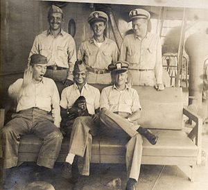 USS Camel (IX-113) - Photo of officers and ship mascot