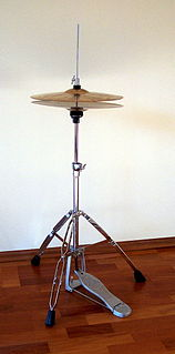 Hi-hat combination cymbal and stand found in a standard drum kit, played by means of a foot pedal