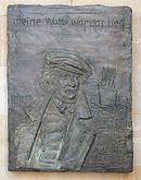 Bronzerelief von Hoffmann von Fallersleben am Leineschloss in Hannover