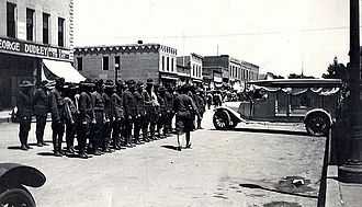 Akron, Iowa - Akron honor guard in 1921 for Private Albert E. Hoschler, the first from Akron to enlist in the World War I, and the first from Akron killed in battle in France (on March 5th, 1918).