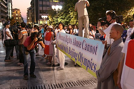 "The banner reads: ""Human Rights Abuse Cannot Co-exist with Beijing Olympics"", picture taken during the opening of the Human Rights Torch Relay event Human Rights Abuse Cannot Co-exist with Beijing Olympics.jpg"