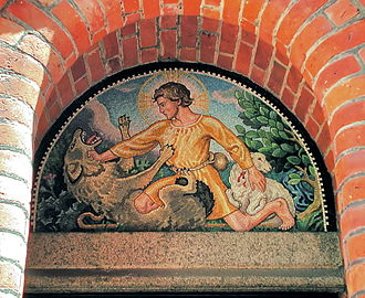 Wolves in folklore, religion and mythology - A mosaic on the entrance of a Church in Denmark depicting the Good Shepherd protecting a lamb from a wolf