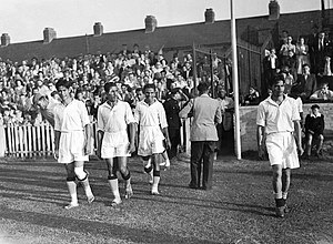 Talimeren Ao, leading India out at Cricklefield Stadium to play against France India vs france 31st july 1948 team arriving.jpg