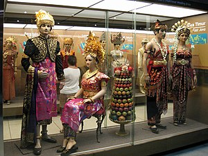 National costume of Indonesia - Indonesia Museum depicting traditional dresses of Indonesia. The picture shows the traditional wedding dress of Bali (left) and East Java (right) with other dresses from other provinces depicted in the background