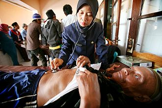 Nursing - A nurse in Indonesia examining a patient