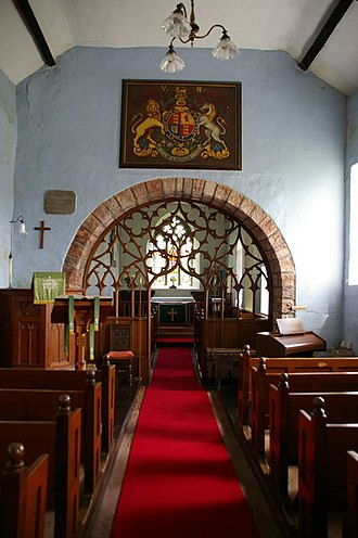 Religious image - Painting of the Royal Arms of the United Kingdom, in its current form, in the parish church of Bolton in Cumbria, England.