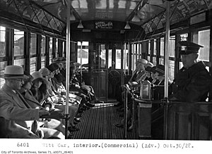 Interior of a Peter Witt streetcar of the TTC, showing the pay upon exit system.jpg