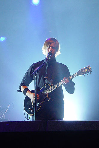 Interpol (band) - Paul Banks, lead singer of Interpol, playing at Roskilde Festival, Denmark 2005 at Arena Stage