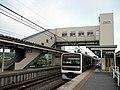 JRE Kuha 208-2110 at Narutō Station.jpg