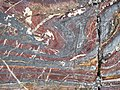 Jaspilite banded iron formation (Soudan Iron-Formation, Neoarchean, ~2.69 Ga; Stuntz Bay Road outcrop, Soudan Underground State Park, Soudan, Minnesota, USA) 43 (19038026218).jpg