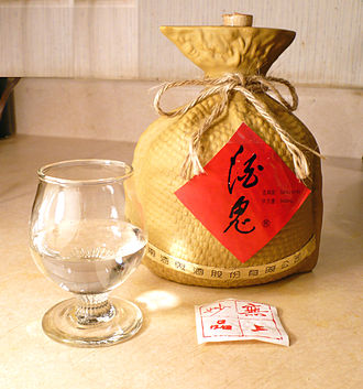 Baijiu - A glass and bottle of Jiugui brand baijiu