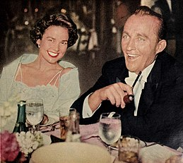 Kathryn Grant with her husband Bing Crosby, 1958.jpg