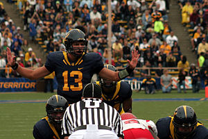 Kevin Riley - Riley calls out signals at the line of scrimmage against Eastern Washington on September 12