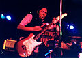 Kim Deal playing guitar with The Amps.jpg