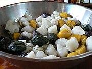 https://upload.wikimedia.org/wikipedia/commons/thumb/6/60/Korean_rice_cake-Songpyeon-01.jpg/180px-Korean_rice_cake-Songpyeon-01.jpg