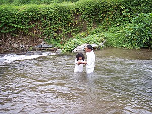 Mormonism - An eight-year-old girl being baptized in Cerro Punta, Panama