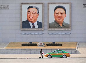 North Korean cult of personality - Large portraits on the wall of the Grand People's Study House, facing Kim Il-sung Square in Pyongyang, North Korea.